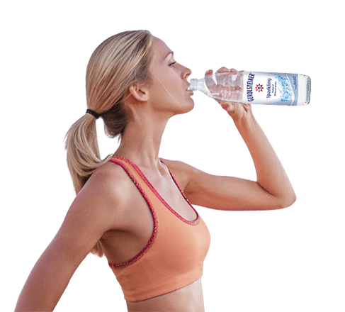 Young woman drinking Gerolsteiner Mineral Water